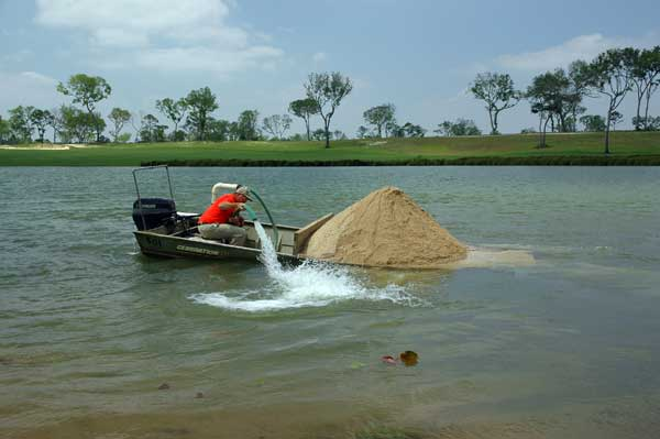 It is easy to overload a flatbottom boat with agricultural limestone. Don't try this at home!