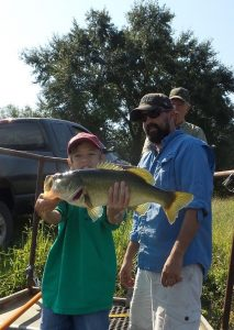 Once they are larger than 6 pounds, hold them like young Reed Graff is doing here.